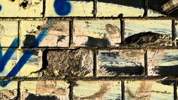 dirt, spray paint, bricks, wwall, different colors
