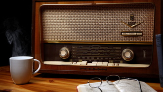 cup, old radio, glasses, wood, book, table