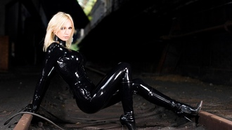 susan wayland, blonde, german, fetish model, busty, sexy babe, long hair, posing, black, shiny, latex, catsuit, pvc, knee boots, rubber, fetish, railroad tracks, susan, fetish supermodel, diva, fetish babe