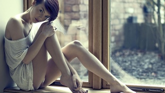 women, window, sill barefoot, short hair, rosie robinson