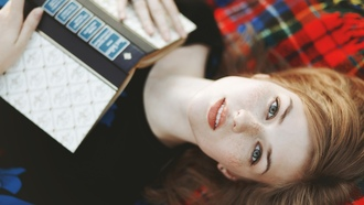 women, redhead, freckles, books, looking at viewer, lying on back
