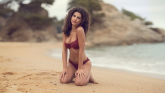 women, brunette, depth of field, kneeling, belly, sand, sea, bikini, curly hair