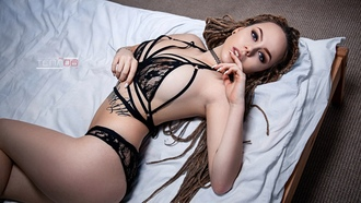 women, dreadlocks, see-through clothing, ass, tanned, choker, tattoo, in bed, top view, black lingerie, blue eyes, belly, white nails