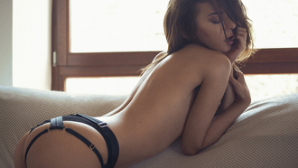 women, tanned, ass, couch, topless, strategic covering, closed eyes