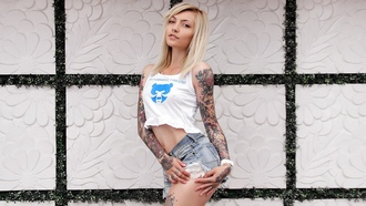 women, blonde, tanned, portrait, nose rings, T-shirt, belly, tattoo, jean shorts