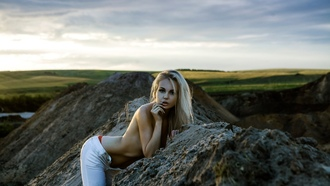 women, blonde, tanned, rocks, pants, jeans, topless, women outdoors, finger on lips, depth of field