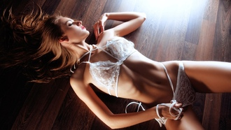 women, white lingerie, tanned, belly, ribs, seethrough clothing, on the floor, top view, lying on back