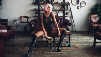 women, wigs, pink hair, monokinis, tanned, kneehigh boots, couch, sitting, looking away