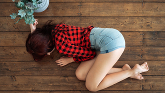 women, plaid shirt, brunette, jean shorts, on the floor, top view, wooden surface, plants
