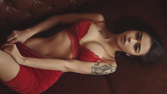 women, red skirt, red bra, tattoo, belly, portrait, top view, hips, couch, lying on back