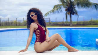 women, swimming pool, smiling, palm trees, curly hair, sitting, onepiece swimsuit, brunette, sunglasses