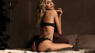 women, blonde, tattoo, in bed, brunette, ass, black lingerie, red lipstick, kneeling, pillow, stockings, looking at viewer