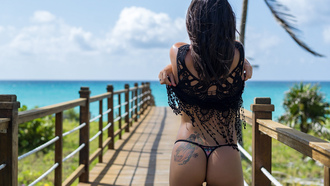 women, ass, sea, tanned, back, the gap, tattoo, undressing, women outdoors, swimwear, red nails, fence, sunglasses