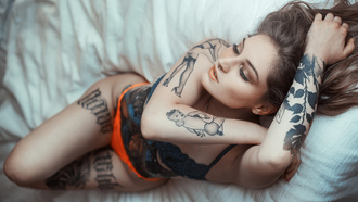 women, nose ring, in bed, orange panties, tattoo, blue bra, armpits, belly, lingerie