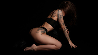 women, black lingerie, brunette, kneeling, ass, black background, painted nails, hair in face, tattoo