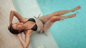 women, swimming pool, black bikini, closed eyes, top view, water drops, wet body, wet hair, brunette, hands on head