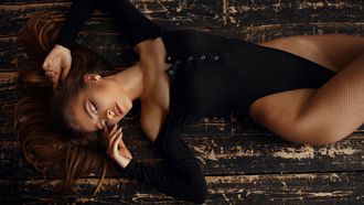 women, top view, eyeliner, wooden floor, leotard, fishnet, closed eyes, lying on back, hoop earrings, brunette
