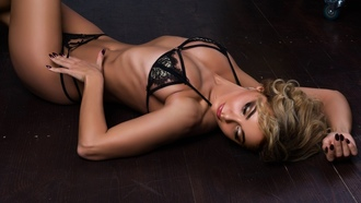 women, blonde, on the floor, ribs, tanned, lying on back, belly, black lingerie, painted nails, wooden floor, looking away