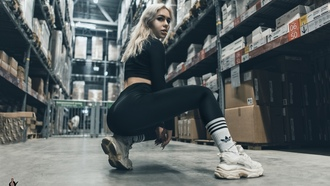 women, squatting, black clothing, hite socks, sneakers, didas, blonde, leggings, looking at viewer, nose ring