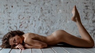 women, nude, tan lines, lying on front, brunette, feet in the air, ass, on the floor