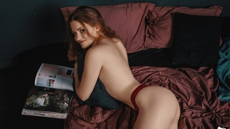 women, red panties, ass, topless, in bed, brunette, magazine, pillow, smiling, strategic covering