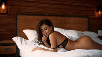 women, brunette, nude, in bed, pillow, lamp, ass, lying on front, black bras, finger on lips, eyeliner