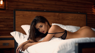 women, brunette, nude, in bed, pillow, lamp, ass, lying on front, black bras, tongues, eyeliner