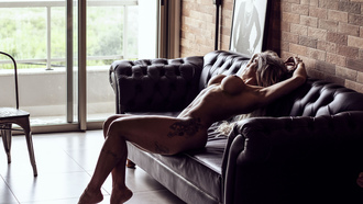 women, couch, nude, chair, belly, tattoo, armpits, boobs, nipples, ribs, pierced navel, looking away