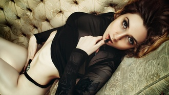 women, brunette, tattoo, couch, black nails, black lingerie, belly, finger on lips, lying on back, eyeliner, seethrough blouse