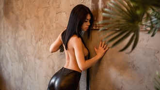 women, topless, portrait, leather leggings, plants, boobs, strategic covering, black hair, wall