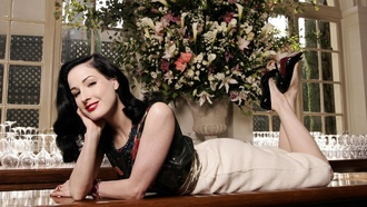 dita von teese, model, sexy babe, actress, glamour, international burlesque star, dita, playmate, dancer, laying, smile, bar, white, skirt, black, heels, red lips, flowers, pin up style