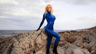 susan wayland, blonde, german, fetish model, busty, sexy babe, long hair, posing, outdoor, rocks, blue, shiny, latex, catsuit, rubber